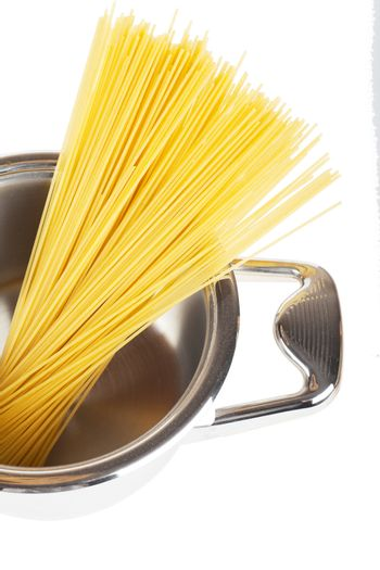 Bunch of spaghetti in a pot isolated over white background