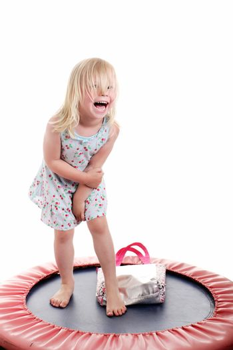 cute little girl on a trampoline