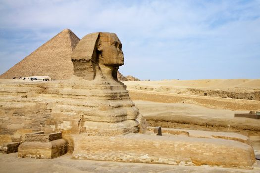Egyptian Sphinx with pyramid in Giza