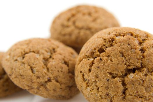 pile of pepernoten (ginger nuts) in closeup, sweets for typical Dutch festivity at 5 december