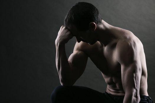 Bodybuilder concentrating