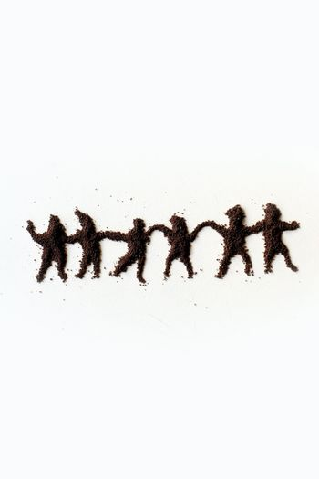 small  figures of man made in chocolate powder