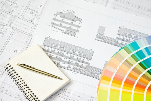 Architectural drawing and notepad
