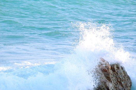 Waves Crashing into the Rock
