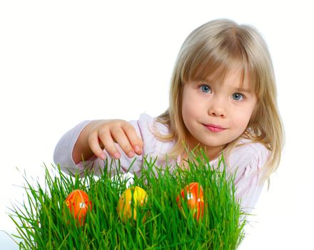 Adorable little girl collecting Easter eggs in her basket. Isolated white backround