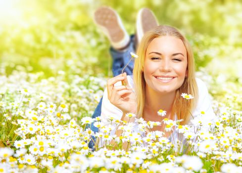 Young lady on daisy field