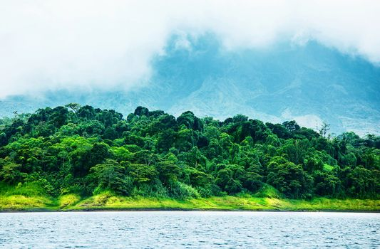 Image of Costa Rica, nature of Central America, fog in the mountains, green forest near river, beautiful landscape, eco tourism, panoramic scene, peaceful nature, travel and vacation concept