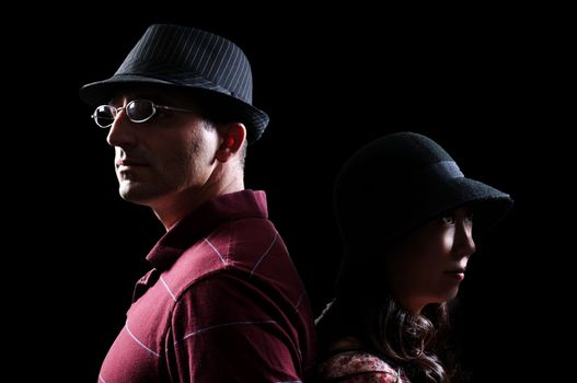 Attractive handsome man in a fedora hat and a woman in a cloche hat