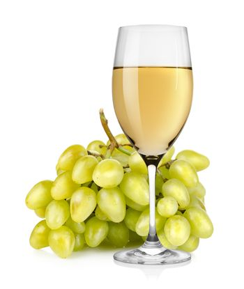 Wineglass and a bunch of grapes