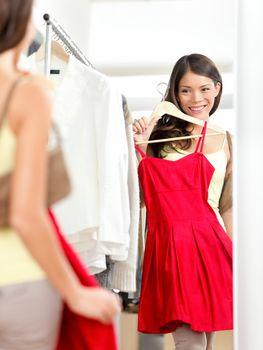 Shopper woman trying clothing dress shopping