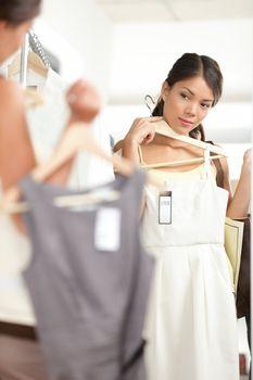 Woman shopping choosing dresses
