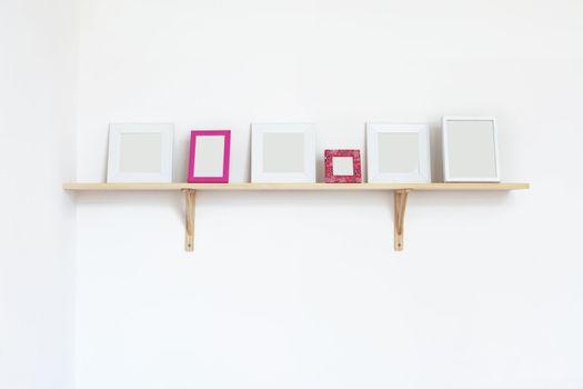 Photo frames on a shelf