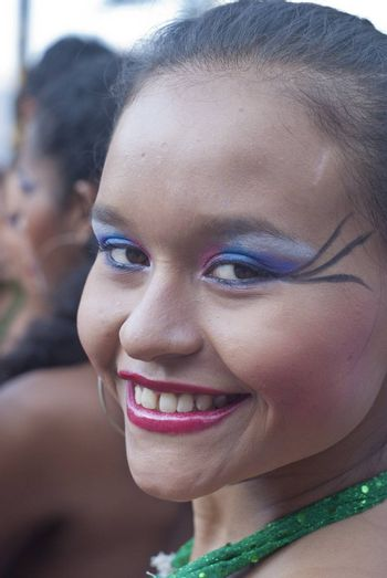 """POLIZZI GENEROSA, SICILY-AUGUST 19:Beautiful Woman of Colombia folk group at the """"Festival of hazelnuts"""",dance and parade through the city:August 19, 2012 in Polizzi Generosa,Sicily, Italy"""
