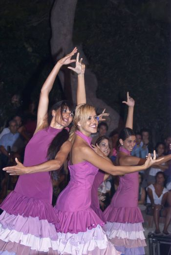 """POLIZZI GENEROSA, SICILY-AUGUST 19:Beautiful Women of Spain folk group at the International """"Festival of hazelnuts"""",dance and parade through the city:August 19, 2012 in Polizzi Generosa,Sicily, Italy"""