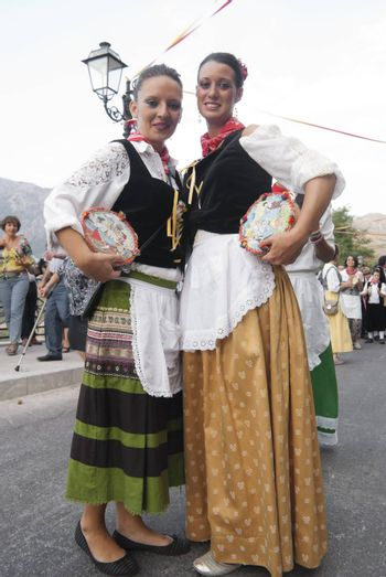 """POLIZZI GENEROSA, SICILY-AUGUST 19:Sicilian folk group from Polizzi G. at the International """"Festival of hazelnuts"""",dance and parade through the city: August 19, 2012 in Polizzi Generosa,Sicily, Italy"""