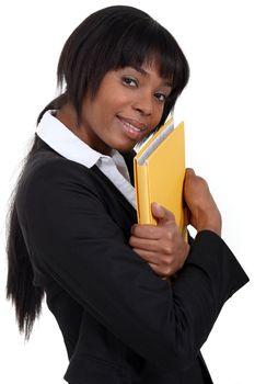 File clerk hugging a folder