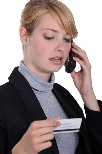 Woman calling her credit card company