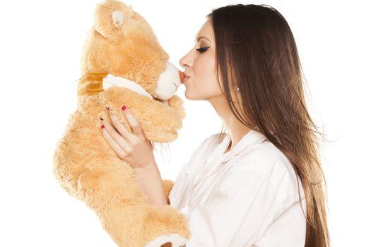 brunette kisses a teddy bear