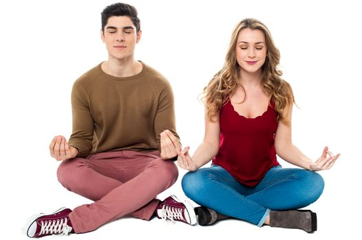Friends meditating in lotus pose, peace of mind