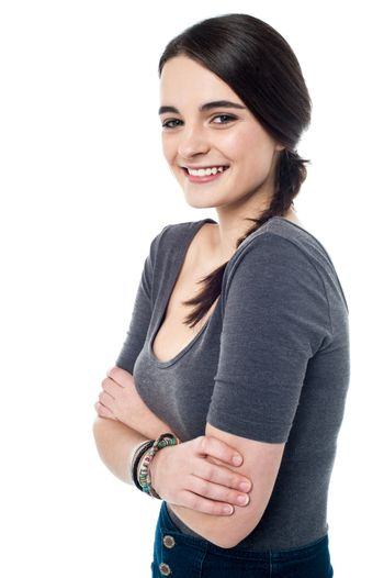 Pretty teenager posing with folded arms