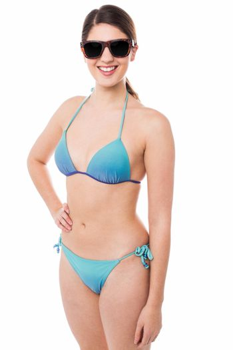 Sexy bikini model passing smile to you