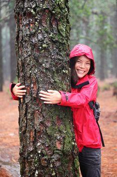 Happy female tree hugger