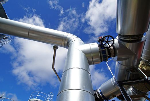 industrial piping and valves against blue sky