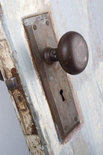 A vintage and worn door, handle and keyhole