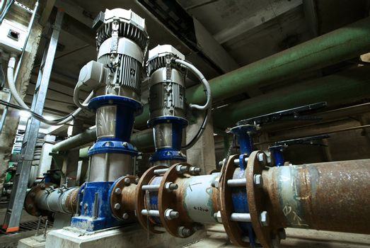pumps, cables and piping as found inside of  industrial power plant