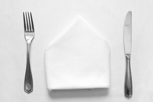 knife, fork and napkin in restaurant