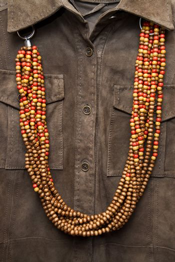 brown shirt with color necklace