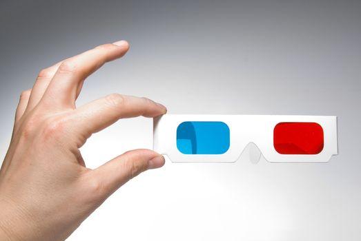 hand holding stereo glasses