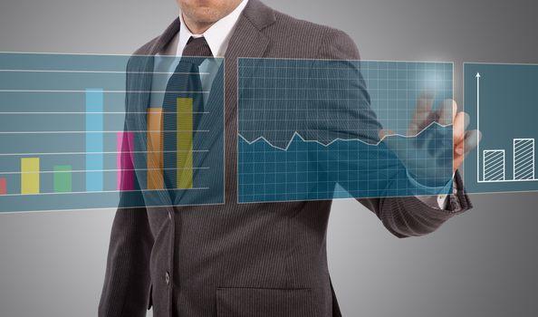 businessman touch graphs