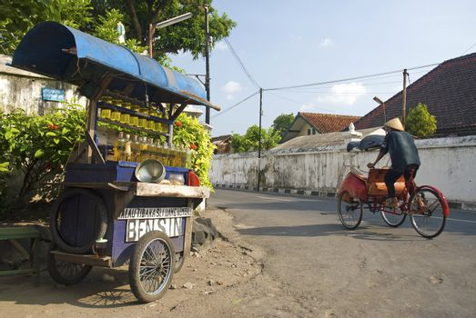 petrol stall and cyclo taxi in solo city indonesia