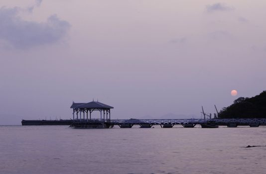 Sunrise at beautiful old bridge on Sichang island , chonburi pro