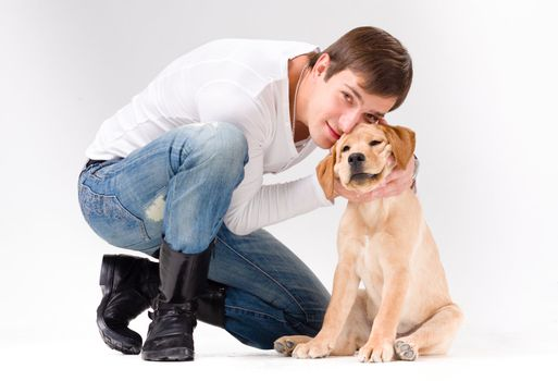handsome man with dog over gray background