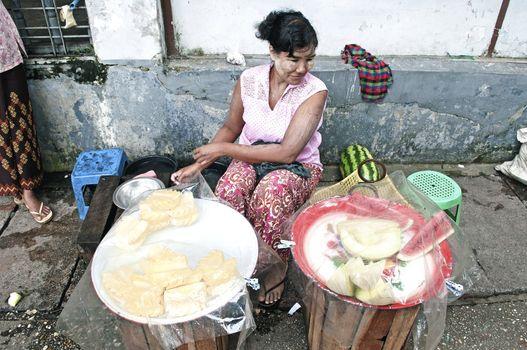 fruit vendor on street yangon myanmar
