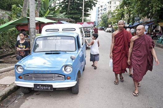 buddhist monks in yangon street myanmar