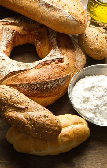ingredients for homemade bread on wooden background