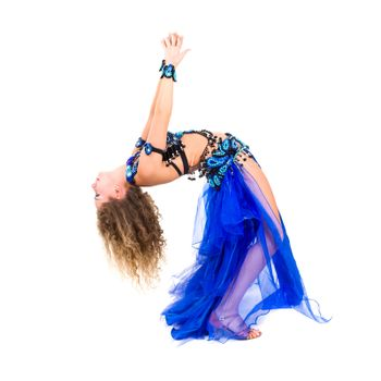 Young beautiful belly dancer in a blue costume full length studio portrait isolated on white