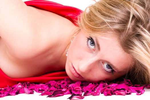 shot of sexy woman in red dress with rose petals, isolated on white background