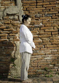 Buddhist woman standing meditating