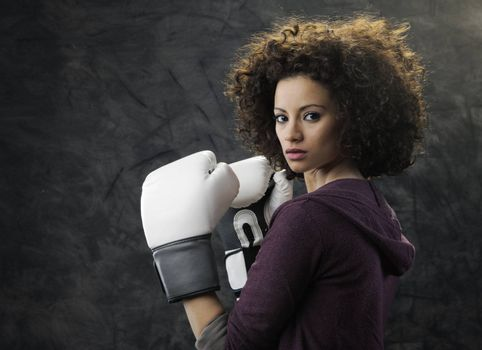 Fashion model with white boxing gloves