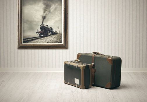 Old-fashioned suitcases alone in a train station.