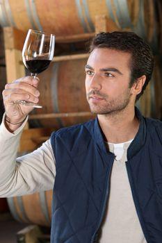Winemaker in cellar with wine Dubroca_Joffrey_140410