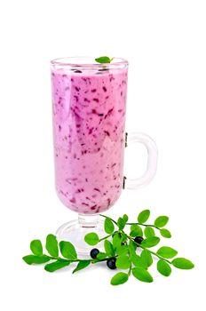 Milkshake with blueberries in a glass goblet