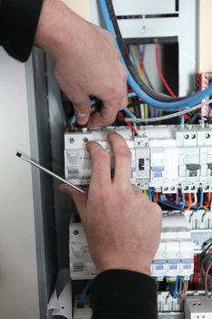 Man at a fuse box