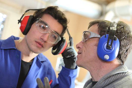 Men wearing ear defenders