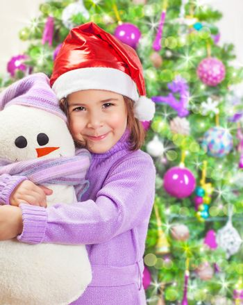 Happy girl with snowman toy