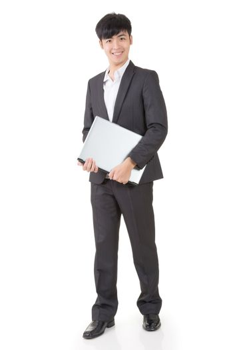 businessman hold a laptop